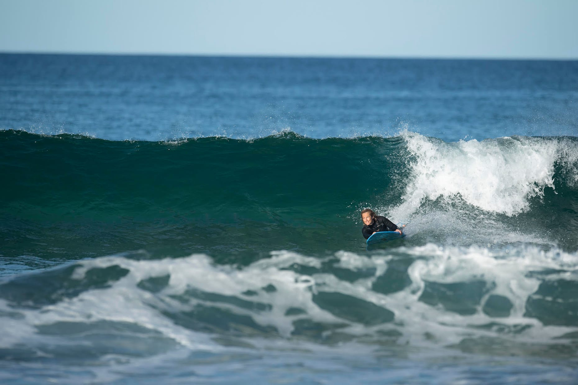 Two-time para surfing world champion Sam Bloom pictured surfing at home in Australia.