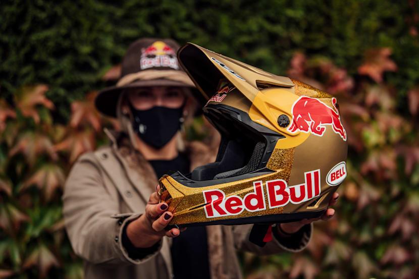 Myriam Nicole holds her custom Red Bull helmet at Leogang MTB World Champs 2020.