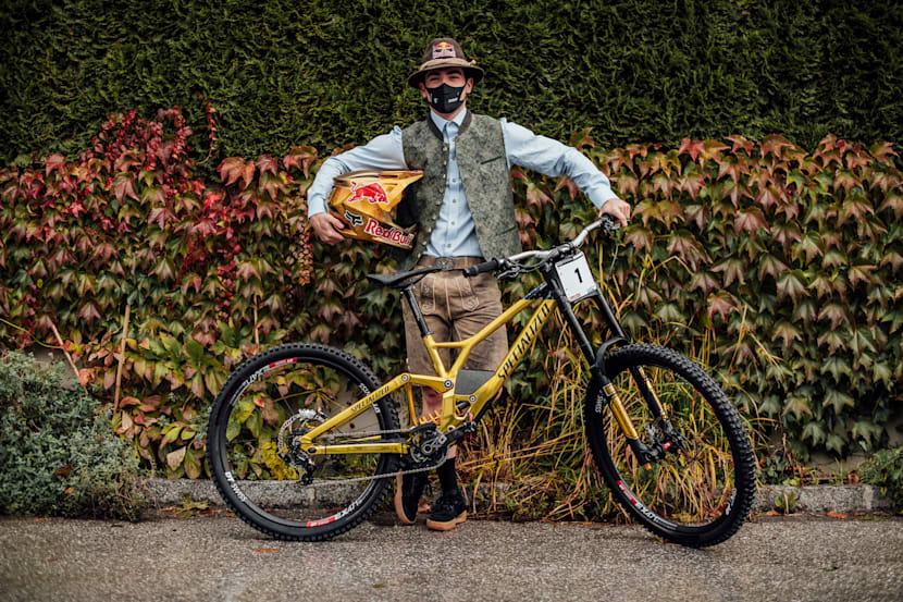 Loïc Bruni stands with his bike and helmet at Leogang MTB World Championships 2020.