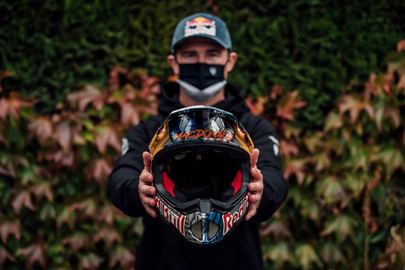 Brook Macdonald holds his custom helmet at Leogang MTB World Champs 2020.