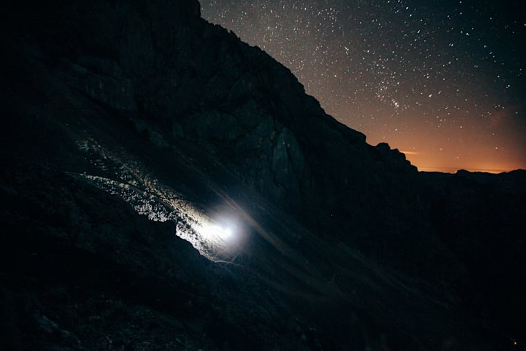 Luka Kovačič of Slovenia runs in the dark as he tackles the five highest peaks in Slovenia in the Julian Alps on August 20, 2020.