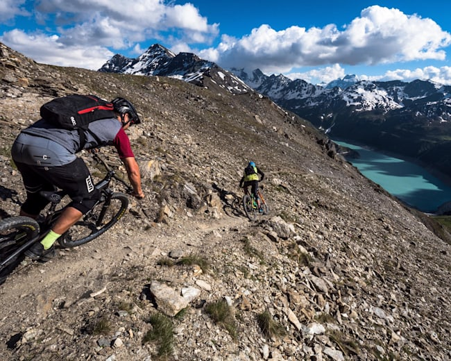 Ludo May and Yann Guigoz ride towards Grimentz in Val d'Anniviers