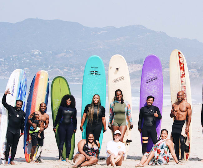 Color the Water surfers enjoy a group lesson in Santa Monica.