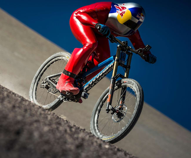 One man with a special suit and a mountain bike