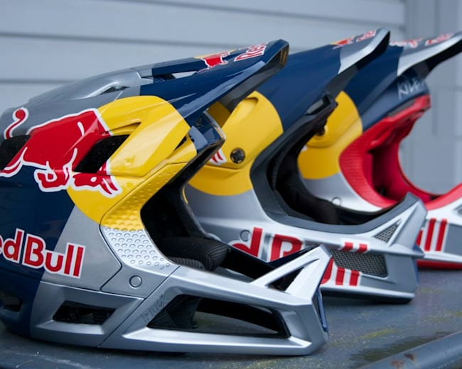 Custom Red Bull helmets painted by Stacy Glaser