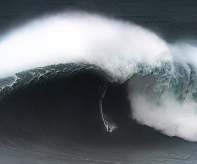 Kai Lenny tackles a monster wave in Nazaré