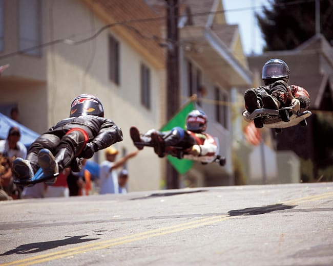 Participants race at the 2002 Streets of San Francisco street luge contest.