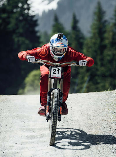 Gee Atherton performs during Leogang DH race