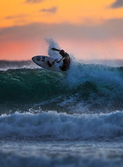 Surfing at sunset is stunning