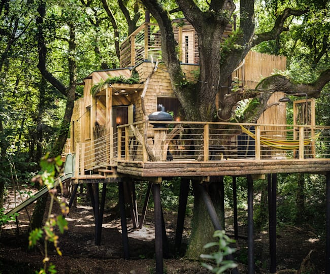 This hideaway includes a revolving woodburner, open-air shower and a slide