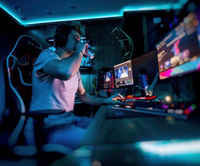 A gamer streaming in a custom room