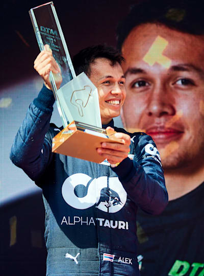 Sweet victory: Alex Albon hoists the winner's trophy at the Nürburgring
