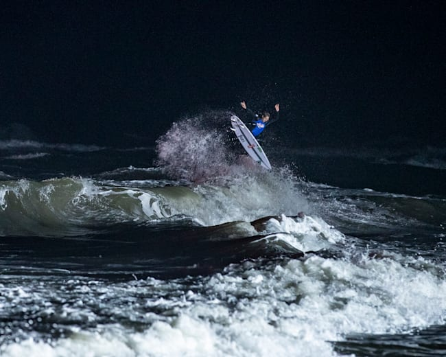 Eric Geiselman competes during Red Bull Night Riders surf competition