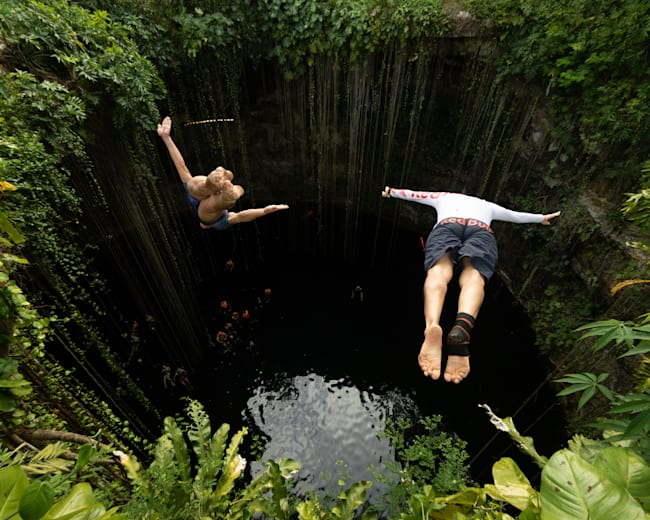 Paredes and Duque leap into Cenote Ik Kil