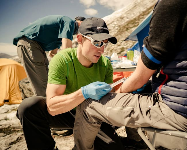 Dr Bakker-Dyos takes a climber's blood sample.
