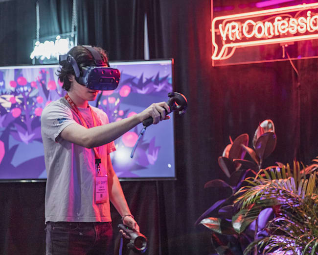 Attendee checks out the VR game at We Are booth at E3 Expo