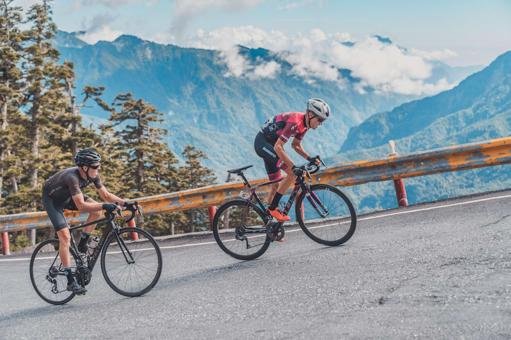 Two cyclists seen taking on a climb in the Taiwan King of the Mountains event.