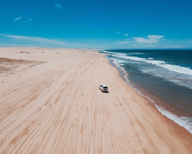 Driving along the beach, Australia.