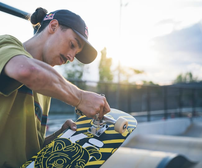 Danny Leon sets up his skateboard