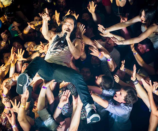 DJ Steve Aoki crowd surfs at a party in Sydney