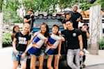 International Red Bull wings team posing together in front of a Red Bull truck