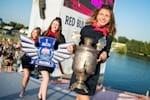 Red Bull college ambassadors carying the trophy of the event Red Bull Flugtage