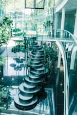 Interior design of the Red Bull base in Austria with many elements made of glass and with stairs in the form of round circles