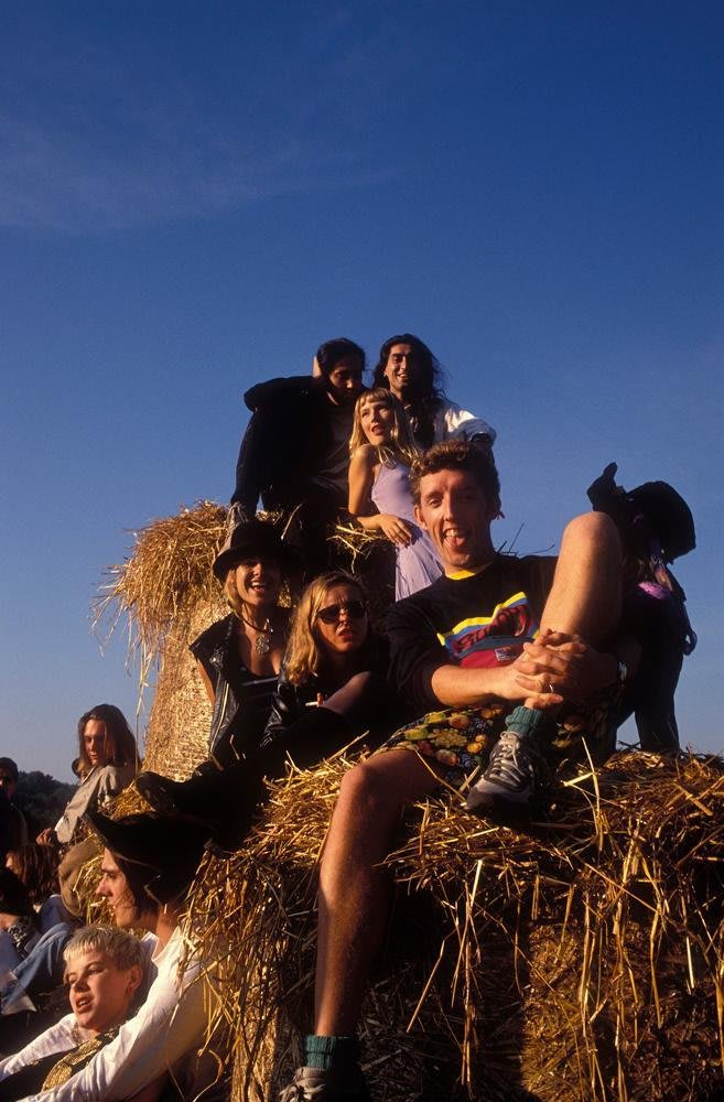 Dave Swindells sitting on hay bales at a rave